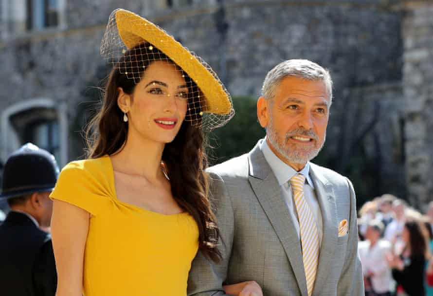 Amal and George Clooney arrive at St George's Chapel, Windsor Castle, for the wedding of Meghan Markle and Prince Harry in May 2018.
