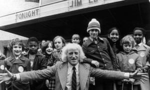Jimmy Savile with part of an audience from Jim'll Fix It in 1974