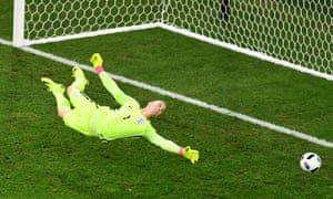 Joe Hart watches a Fedor Smolov shot fly just past the post in the second half.