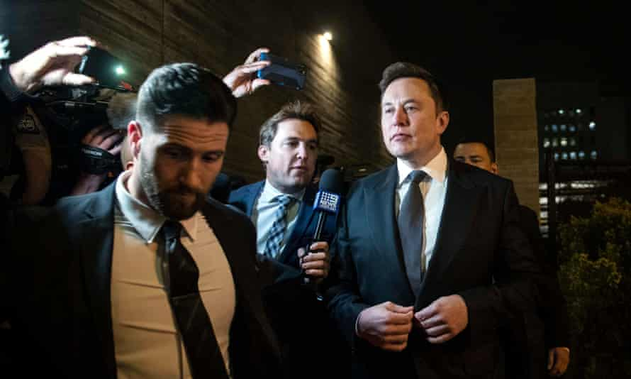Elon Musk leaves after the first day of the trial in Los Angeles.