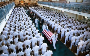 The casket of John McCain is carried during his funeral service.