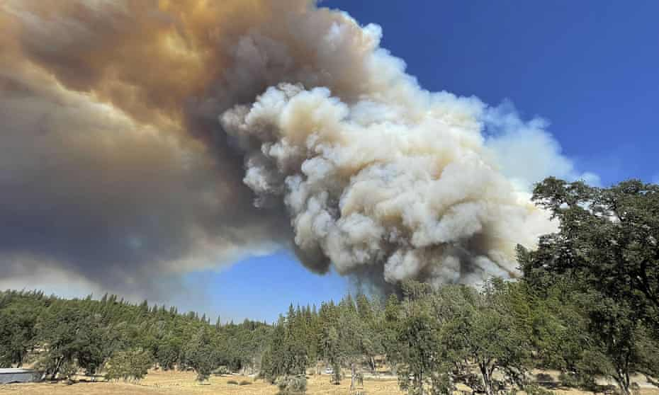 A large plume from the River Fire fills the air with smoke in Colfax, California.
