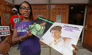 Fans of Aretha Franklin with old vinyl records outside the New Bethel Baptist church. Franklin's father led the church for three decades and Aretha sang gospel there.