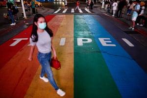 A pedestrian wears a mask in Taipei.