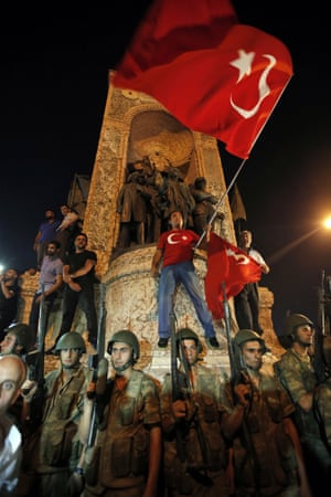 Turkish soldiers secure the area as supporters of Turkey's President Recep Tayyip Erdogan protest in Istanbul's Taksim Square.