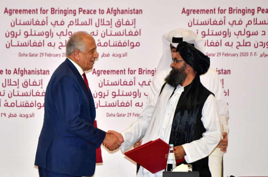 2020: US Special Representative for Afghanistan Reconciliation Zalmay Khalilzad and Taliban co-founder Mullah Abdul Ghani Baradar shake hands after signing a peace agreement during a ceremony in the Qatari capital Doha.