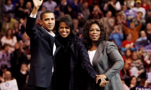 Oprah Winfrey appears alongside Barack and Michelle Obama at a rally in Manchester, New Hampshire, in support of Obama's presidential run.