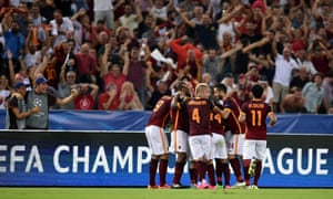 The Roma fans and players celebrate.