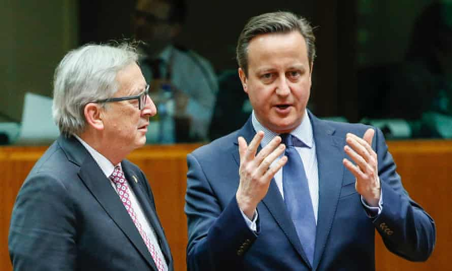 European commission president Jean-Claude Juncker (L) speaks with David Cameron at the start of the EU summit on 18 February 2016 in Brussels