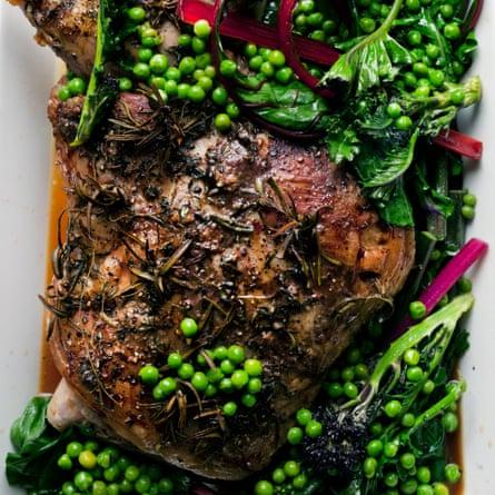 Roast shoulder of lamb with summer greens.