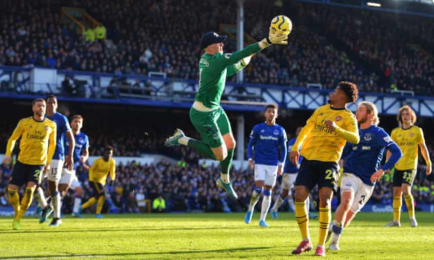 Everton's Jordan Pickford claims the ball above Reiss Nelson of Arsenal during their goalless draw at Goodison Park