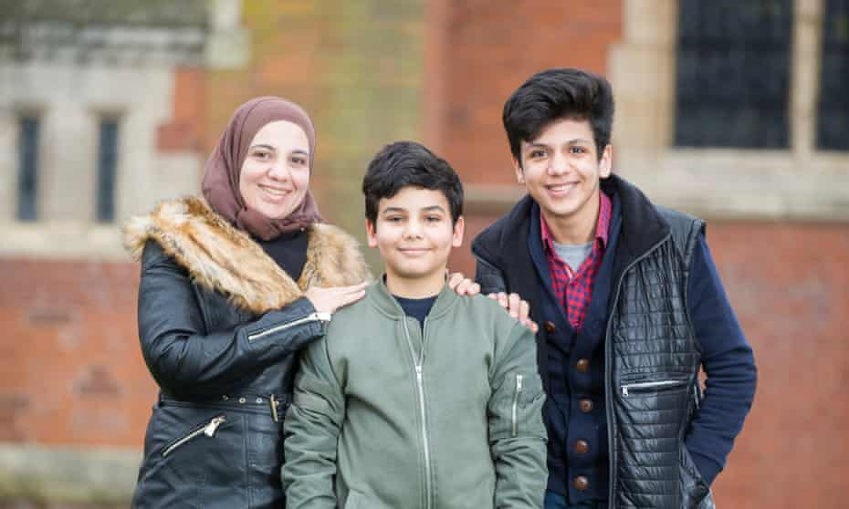 Manal Rwaeh with her sons Ihab, 11, and Bilal, 14.