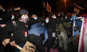Israeli police officers detain a protester during a demonstration against Israel's Prime Minister Benjamin Netanyahu, in Jerusalem.