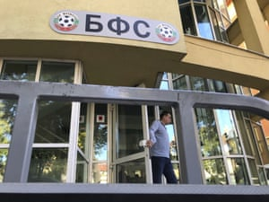 A person leaves the headquarters of the Bulgarian Football Union in Sofia on Tuesday afternoon.