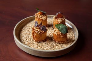 'Four circular, 50 pence-sized lumps of prawn toast laced with sesame kimchi.'