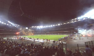 Juventus fans strain to see the action as their team face Roma at the unloved Stadio Delle Alpi.