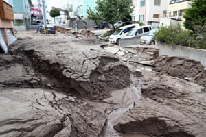 Mud covers cars on a destroyed street after liquefaction and other quake-related phenomena in Sapporo