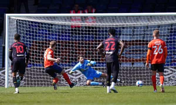 James Collins scores the winner for Luton from the penalty spot.
