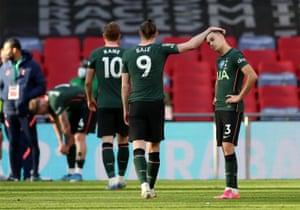 Sergio Reguilon of Tottenham Hotspur is consoled by Gareth Bale.