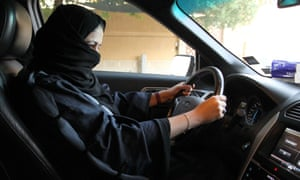 A woman sits behind the wheel of a car in Riyadh last month.
