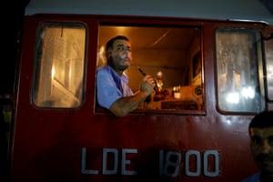 A train driver smokes a shisha after arriving at the fair.