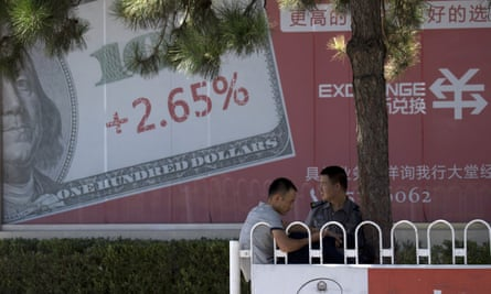 A billboard in Beijing, China, promotes deposit rates for the US dollar.