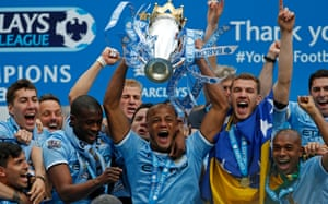 11 May 2014: Kompany lifts the Premier League trophy after the beating West Ham United 2-0.