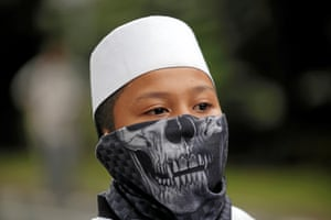 Jakarta, Indonesia: A member of hardline Muslim groups attends a protest against Jakarta's incumbent governor