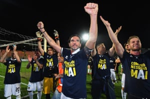 Alessandro Lucarelli leads the celebrations after Parma's promotion to Serie A.