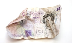 A crumpled dirty £20 note