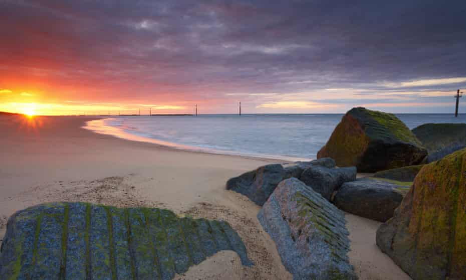 Sunset at Waxham on the Norfolk coast, with its sea defences visible just offshore
