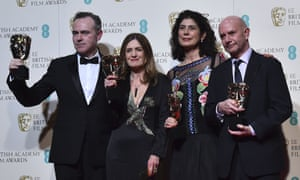 Director John Crowley, producer Finola Dwyer, producer Amanda Posey and screenwriter Nick Hornby pose with their awards for an outstanding British film for 'Brooklyn'