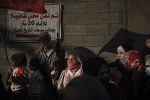 A Palestinian woman holds a rifle during a rally organised by the Popular Front for the Liberation of Palestine in Gaza City.