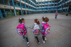 Gaza City, Gaza Strip. Palestinian girls walk to their school after five months of closure