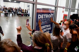 Trump supporters outside a room where absentee ballots were being counted at the TCF Centre in Detroit, Michigan