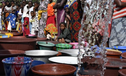 Water is distributed in Bouake on the Ivory Coast in June 2018. The dam that provides 70% of the water for the city is dry. Officials blamed the shortages on a drought inflicted by global warming.