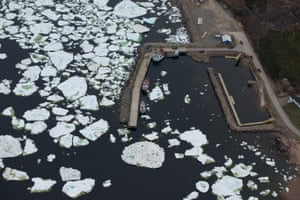Fishing boats at L'Anse-au-Loup blocked by pack ice.
