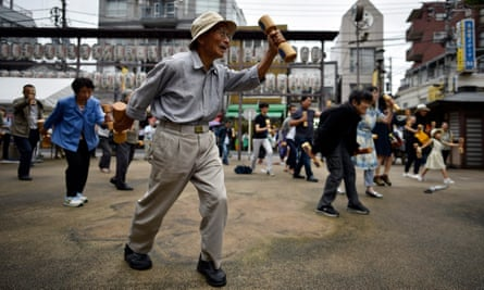 People exercise during an event marking Respect for the Aged Day in Tokyo, Japan.