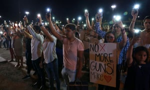Mourners in Ciudad Juárez take part in a vigil after a mass shooting at a Walmart store in El Paso, Texas.