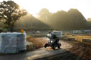 The Grass Bandits mower flies through the chicane in the early morning.