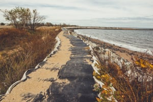 An artificial barrier surrounds the beach in the Midland neighborhood of Staten Island. The area received heavy flooding after Hurricane Sandy.