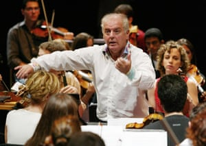 "Daniel Barenboim conducts the West-Eastern Divan Orchestra during a rehearsal for a Proms performance at the Royal Albert Hall, London, August 2003. <a href=""http://www.theguardian.com/music/2003/aug/25/classicalmusicandopera.proms2003"">Read our review</a>."