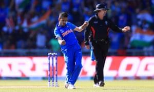 India's Yuzvendra Chahal celebrates taking the wicket of West Indies' Jason Holder, caught by Kedar Jadhav.