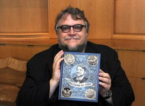 Del Toro with the catalogue for his show.