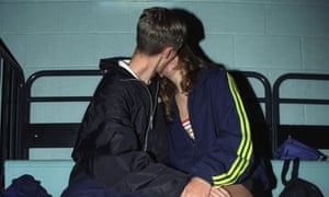 Young couple kissing at an ice rink