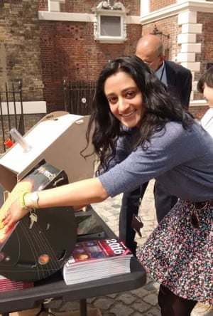 Astronomer Dhara Patel at the Royal Observatory with a sophisticated cardboard transit viewer.