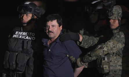 Joaquín 'El Chapo' Guzmán is escorted to a helicopter at Mexico City's airport.