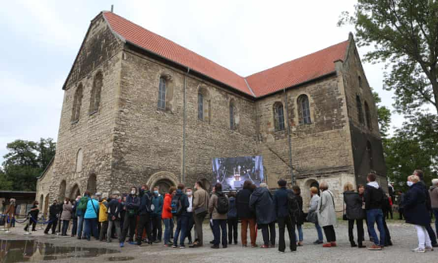 Visitors queueing in front of the Burchardi church to experience the change of sound of the John Cage Organ Foundation