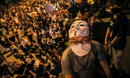 A man wearing a mask attends a protest Chater Garden in Hong Kong. Critics say Apple removed the HKmap app used by protesters after pressure from Beijing.