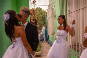 Teens gather in the courtyard of a church as they prepare for their friend's quinceañera festivities